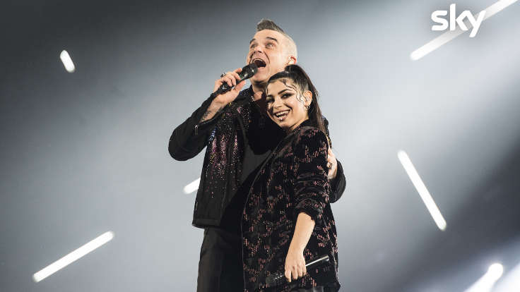 Robbie Williams con una concorrente di X Factor